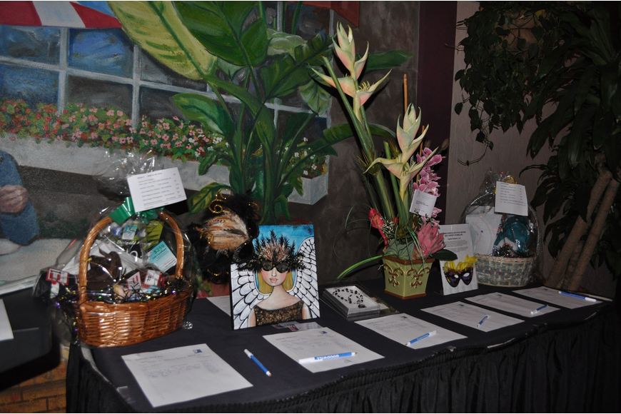 One of the many silent auction tables set up in the courtyard.