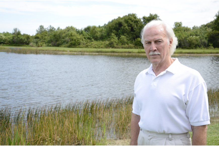 "Ron Jarvis has spent years observing the alligators that have made their home in the pond behind his house. ""It's neat to see alligators — they're smarter than people think,"" he said. Photo by Jessica Salmond"