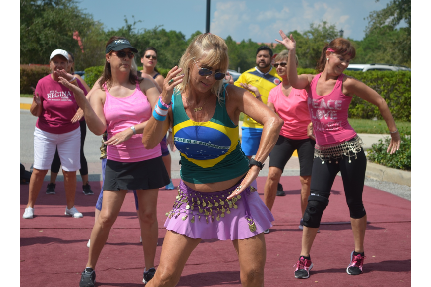 Sandrina Bellino, a Zumba instructor in Lakewood Ranch, leads a latin inspired dance during the Viva festival.