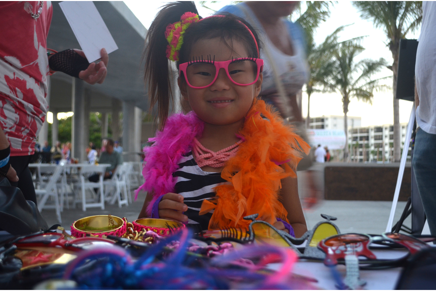 Chloe Light found a rad pair of glasses to match her pink leg warmers at the photo booth during Sandfest.