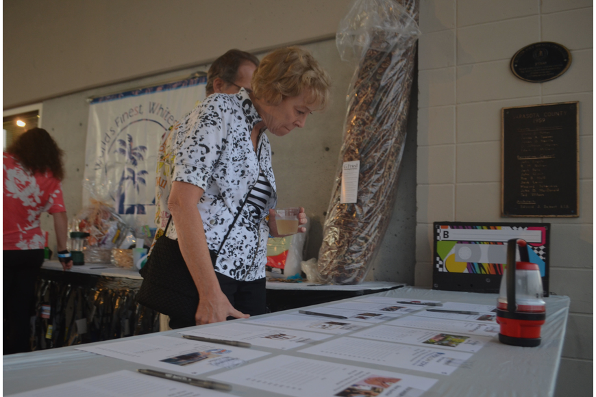 Marilyn Kneafsey looks at the prizes available for silent auction.