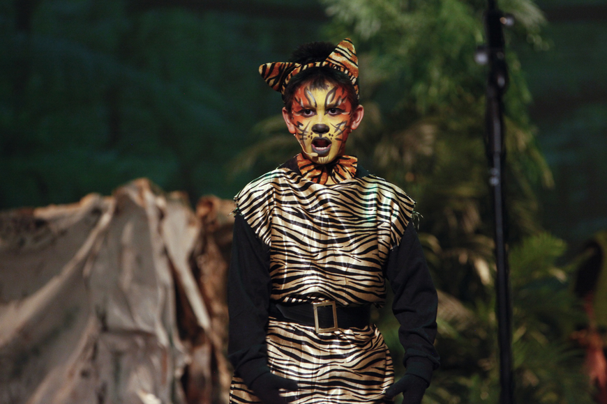 Jacob Mazzone makes a mighty Shere Khan, the tiger. Ashley Murnen portrays Baloo, the bear, in