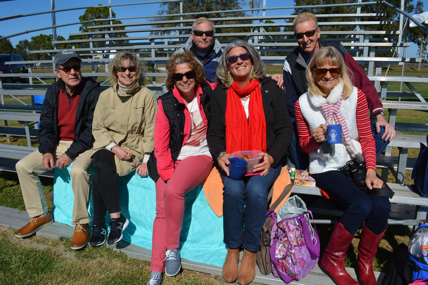 Phil and Chris Zimmerman, of Venice; Karen and Ross (behind) Versaggi, of Punta Gorda; Kathleen Popper, of Treasure Island; and George (behind) and Leesa Carlin, of Sarasota, brought hot chocolate to sip while watching the match.