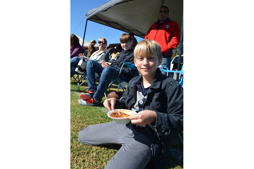 Will Ales, a student at Mills Elementary, feasts on chili with his family.