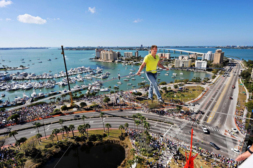 Nik Wallenda, shown in 2013 walking a wire over U.S. 41 in Sarasota, told ODA students the more they give, the more they will benefit.