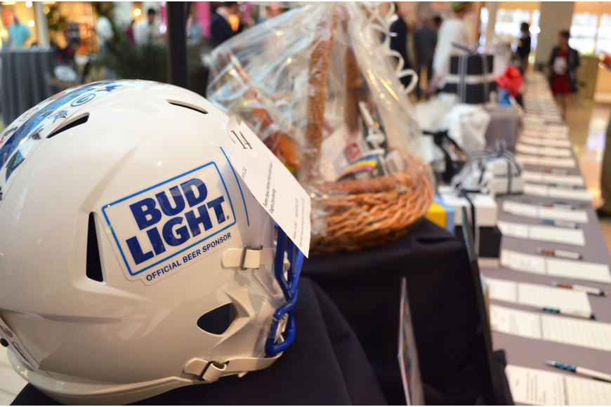 Silent auction items ranged from tickets to productions by nearly every local theatre company to a Bud Light Super Bowl helmet from Gold Coast Eagle Distributing at iconcept 2017 on Feb. 19 at Saks Fifth Avenue.