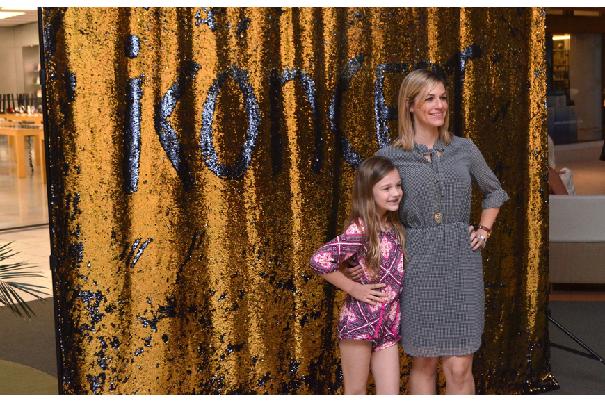 Taylor Snelling and her mom, Nicole Snelling, get their photo taken at the photo booth.