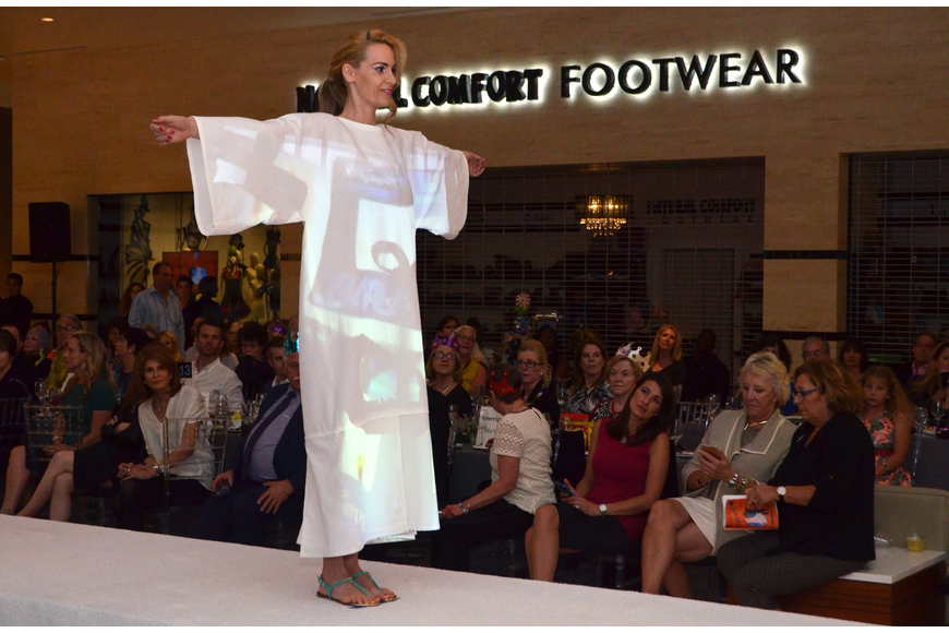 The show opened with a special multimedia fashion piece that incorporated art projected onto a white garment.