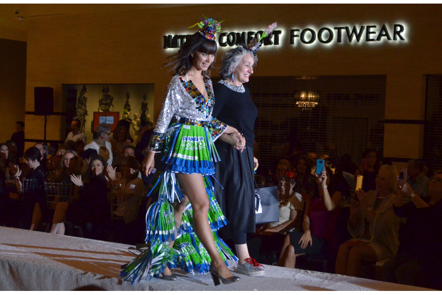 "Top three juror's pick winner Andrea Silvergleit accompanies Julia Kalinina on the runway as she models ""You Are What You Eat"" for a second time."