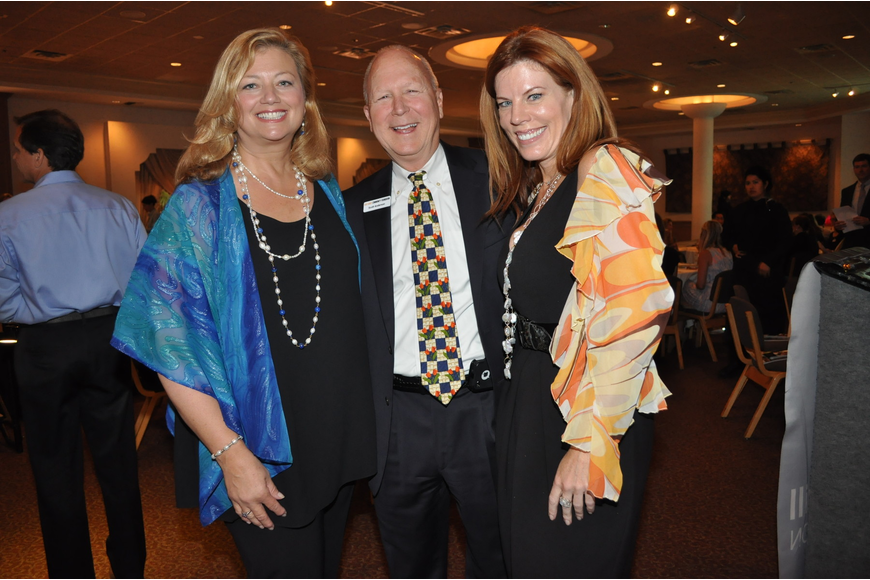 Co-Chair Susan Brennan, Emcee Scott Anderson and Co-Chair Renee Phinney