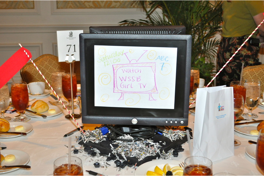 Media centerpieces focused on newspapers, magazines, film, social media and television filled tables.