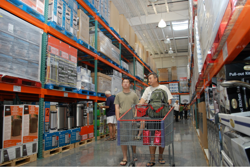 Nick Chin, and his father Getty, browse the selection of products at Costco, which opened today in Sarasota Square Mall.
