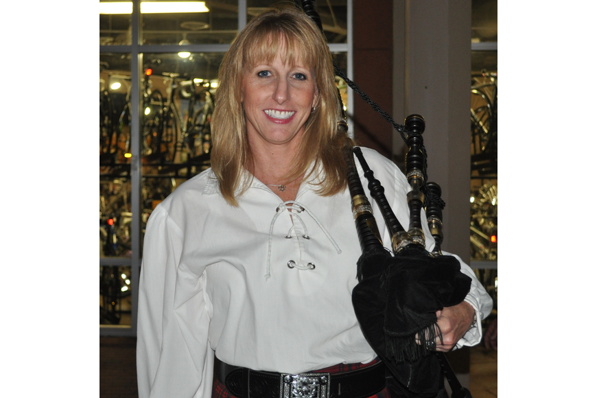 Anne Miller held her bagpipe.