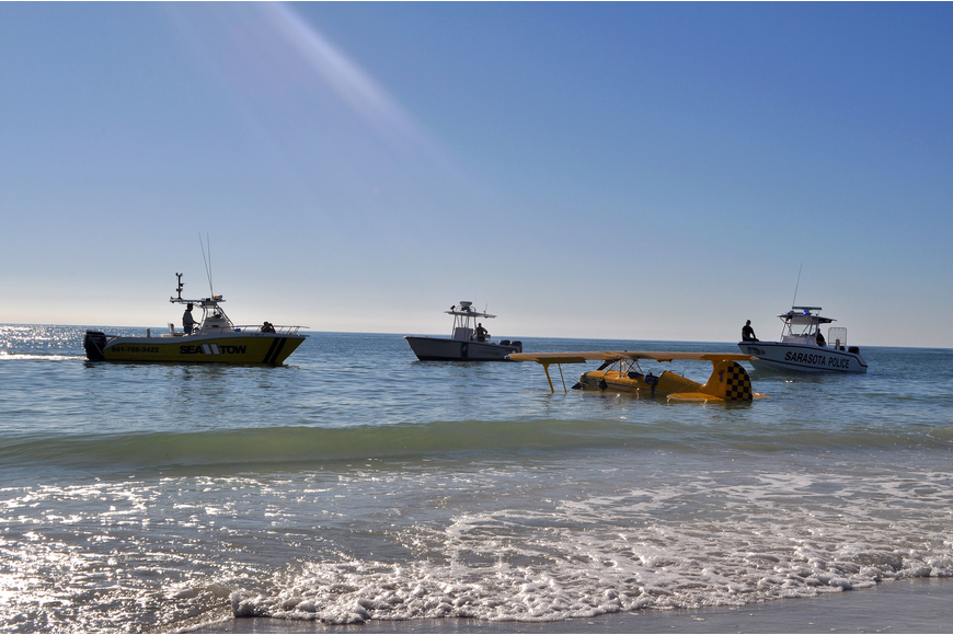 The plane was pulled out of the water with the help of Sea Tow, The Sarasota Police and Beach Patrol. Photo by Rachel S. O'Hara