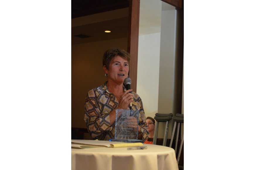 "Cheryl Gaddie thanks the Siesta Key Chamber of Commerce for choosing her as 2012 Business Person of the Year. She said ""it takes a whole village to be a village."""