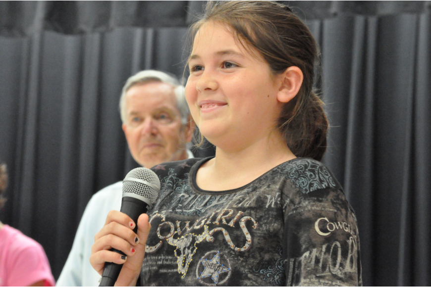 Student Council member Isabelle Chamness told students about an upcoming fundraiser for Southeastern Guide Dogs.