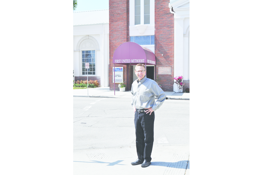 The Rev. Arthur McClellan stands in front of the Pineapple Avenue entrance, which will have glass doors and new canopies after it is remodeled to be more identifiable and welcoming to passersby.