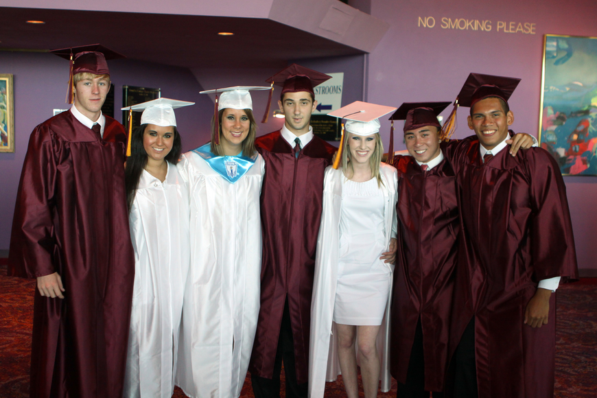 Stephen Hueston, Alyssa Nutter, Lauren Kennedy, Andrew Interial, Taylor Keenan, Jason Rosales and Jereme Johnston pose together while they wait down stairs prior to graduating Friday, May 27 at the Van Wezel.