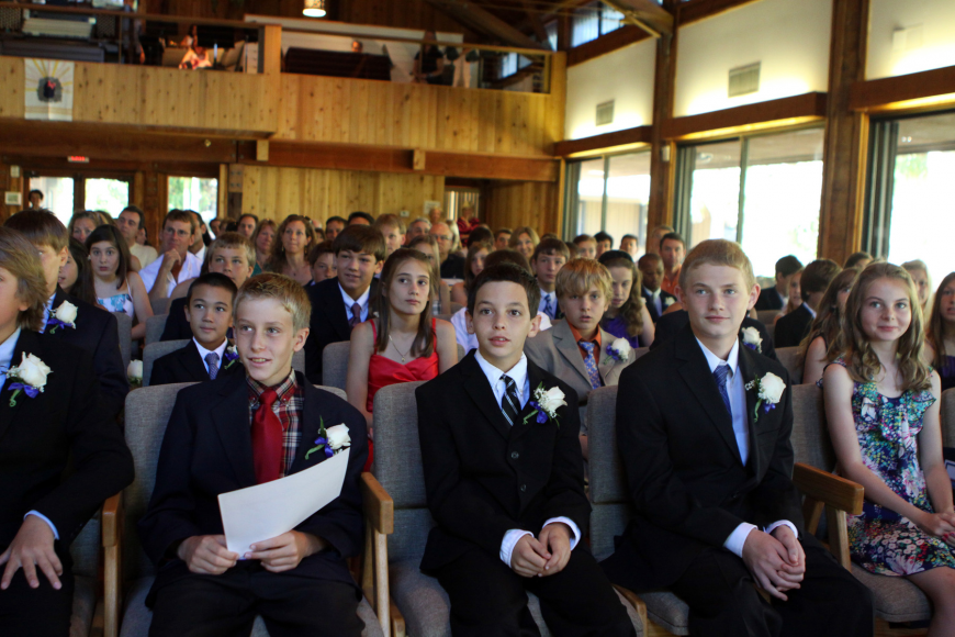 Students smile and listen to Ken Melber speak Friday, June 3 during ODA's 6th grade graduation at Siesta Key Chapel. This was Melber's final year at ODA and he will be heading back to England.