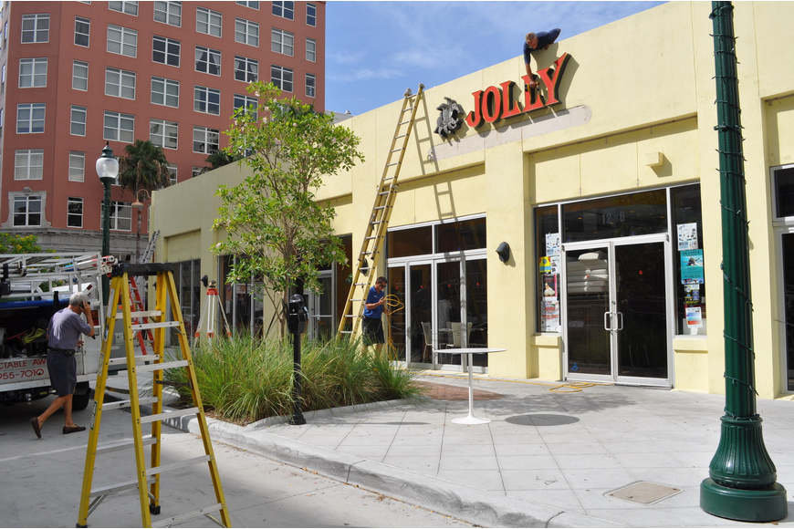 Men were hard at work this morning adding awnings to the Cafe Epicure/Jolly building.