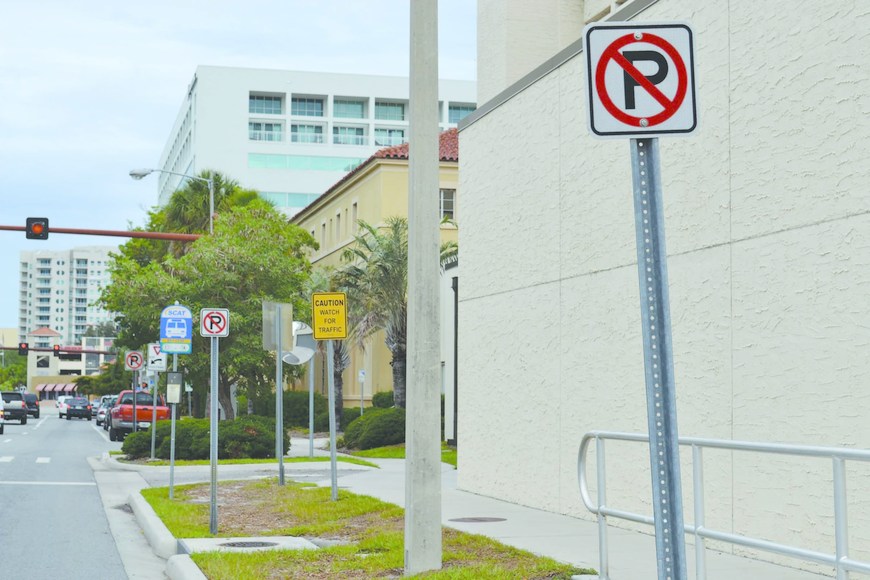 This photo of Ringing Boulevard, in front of the county jail, shows three no-parking signs within about 30 feet, as well as four other signs in the same space.