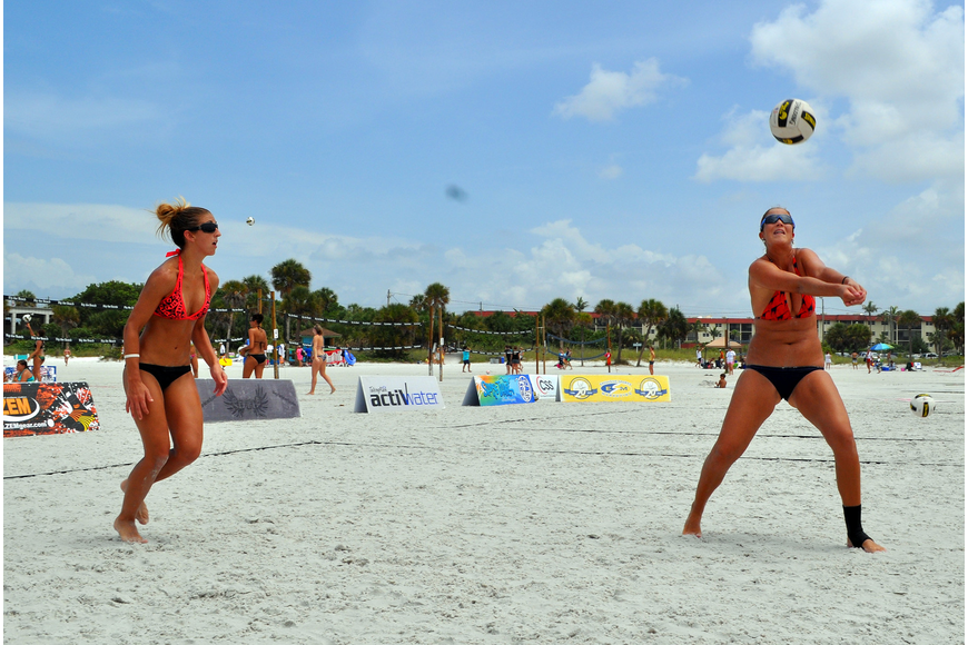 Livia Mendonca hits the ball as Melissa Roberts prepares to help out her teammate during the Siesta Key Gulf Open, Saturday, July 9 at Siesta Key Beach.