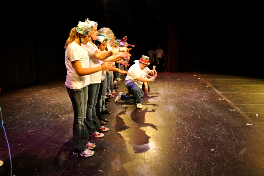 "The Players Theatre campers rehearse ""School of Rock"" before an audience of summer campers."