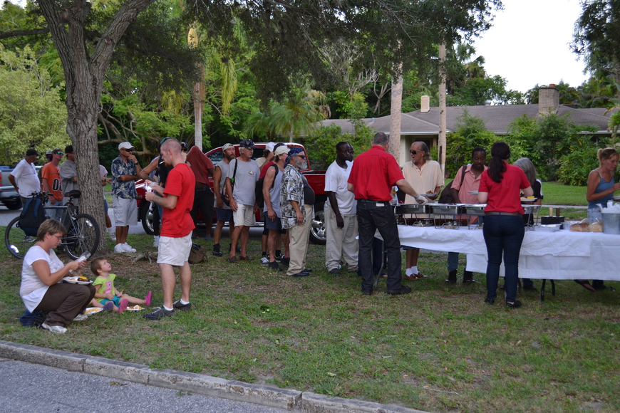 About 40 homeless people were fed in front of Vice Mayor Terry Turner's Cherokee Park home.