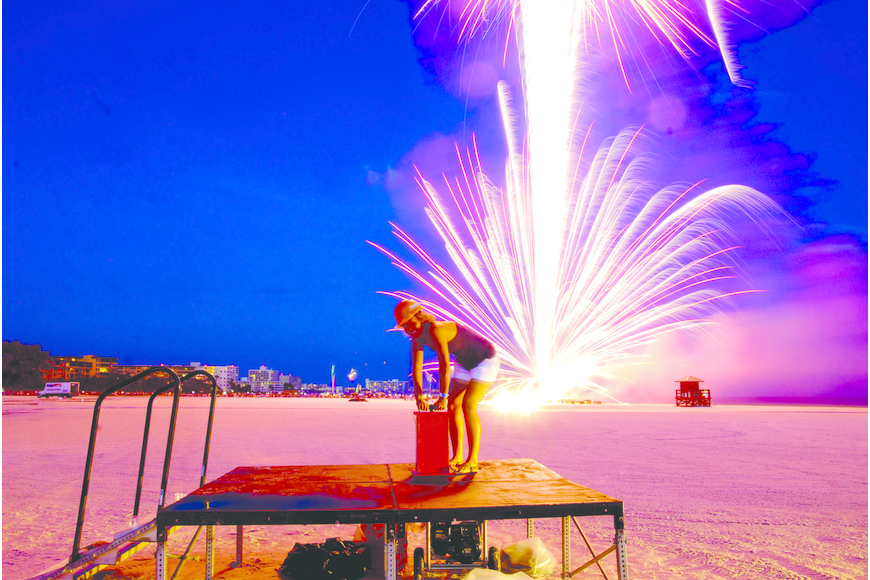 Holly Ferguson sets off the first firework July 4, on Siesta Key.