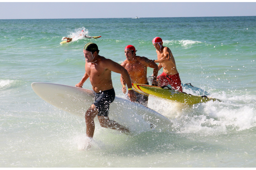 "It was a close call between three of the lifeguards in the men's rescue board race Thursday, July 14 during the 2011 James ""MAC"" McCarthy Southeast Regional Lifeguard Competition."