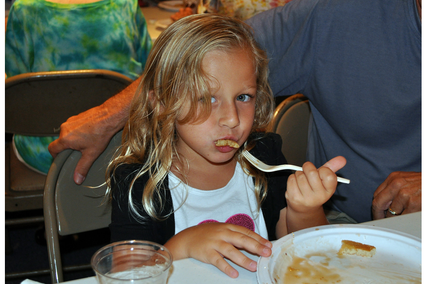 Lucy Zee, 5, takes a bite of one of her pancakes at the pancake breakfast put on by the Knights of Columbus Sunday, July 17 at St. Michael the Archangel Catholic Church.