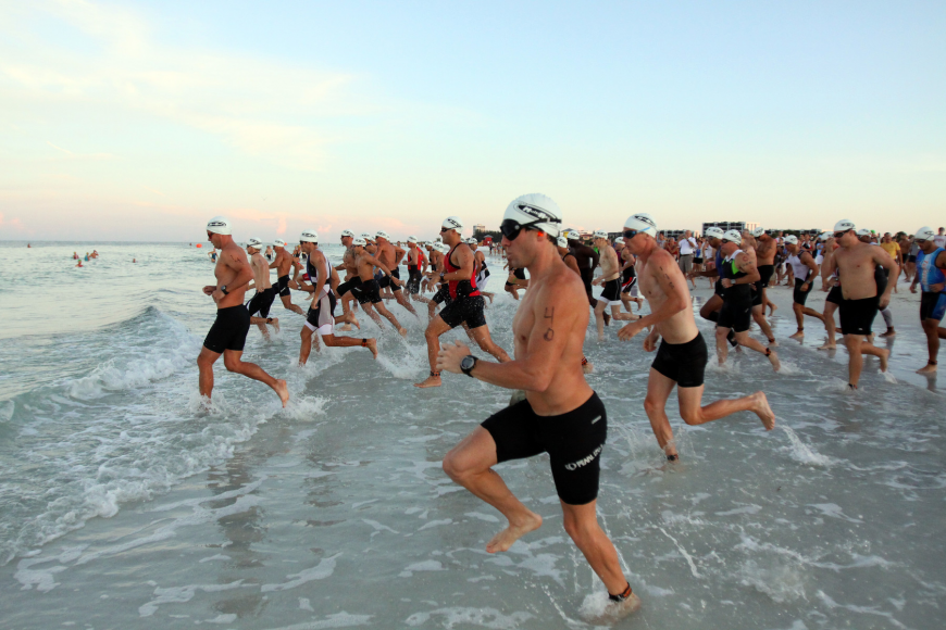 The first wave of Olympic triathletes hit the water at 7 a.m. Saturday, July 23 as part of the Siesta Key Triathlon out at Siesta Key Public Beach