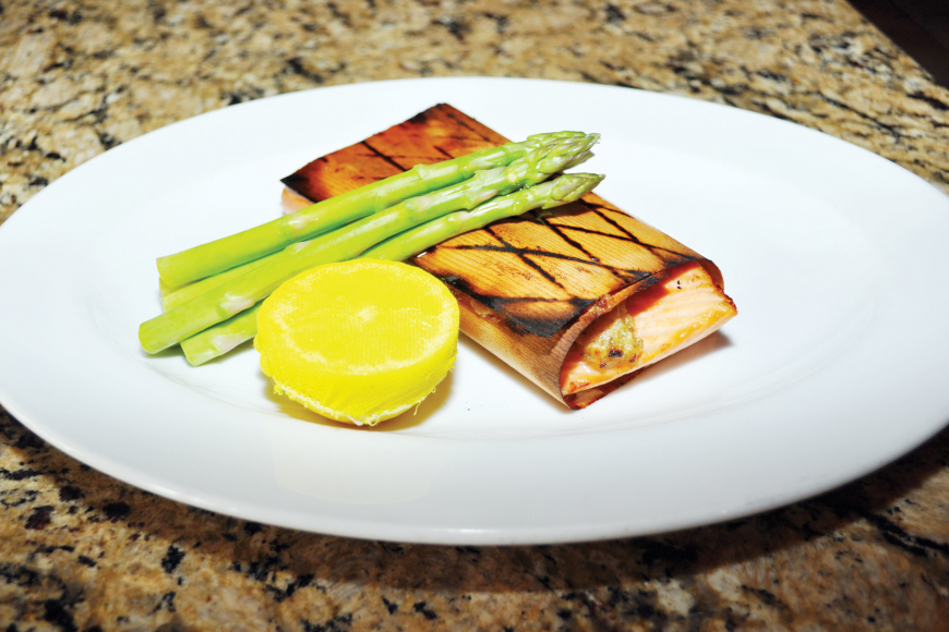 The cedar-wrapped salmon with a maple-Dijon crust is one of Libby's signature dishes.