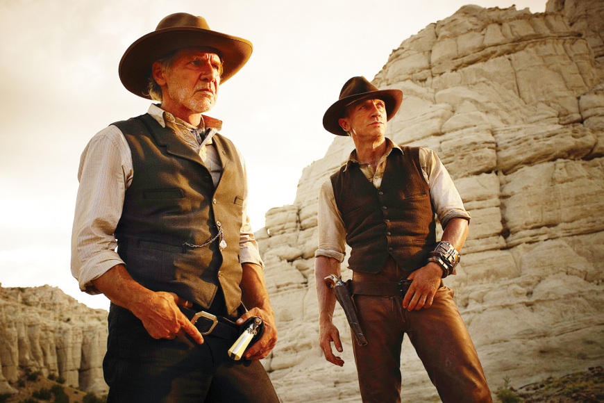 "Harrison Ford and Daniel Craig team up to fight the bad guys in the new sci-fi Western, ""Cowboys and Aliens."""