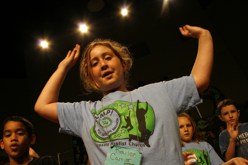 Kailee Carrier helped lead her fellow campers in a song on the last day of Vacation Bible School.