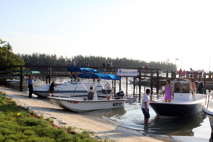 People start to board their boats to head out to look for scallops Saturday, August 13 during the 4th Annual Sarasota Bay Great Scallop Search.