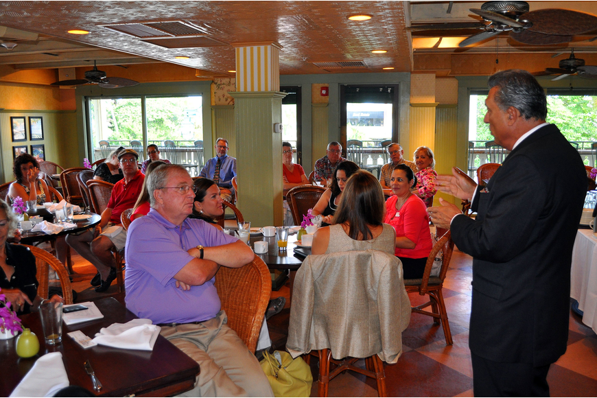 President Andrew Vac speaks to the members of the Circle Association Tuesday, Aug., 16 at Tommy Bahama Restaurant.