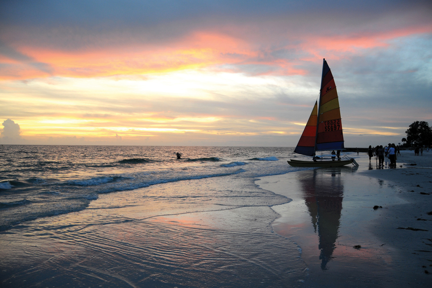 Rebecca Wild Baxter took this photo of friends preparing for a late-evening sail at Siesta Beach.