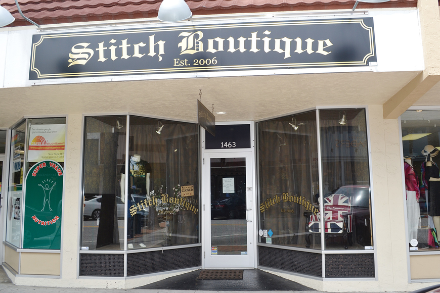 A sign on the door at Stitch Boutique states the clothing store is closed for fall renovations.