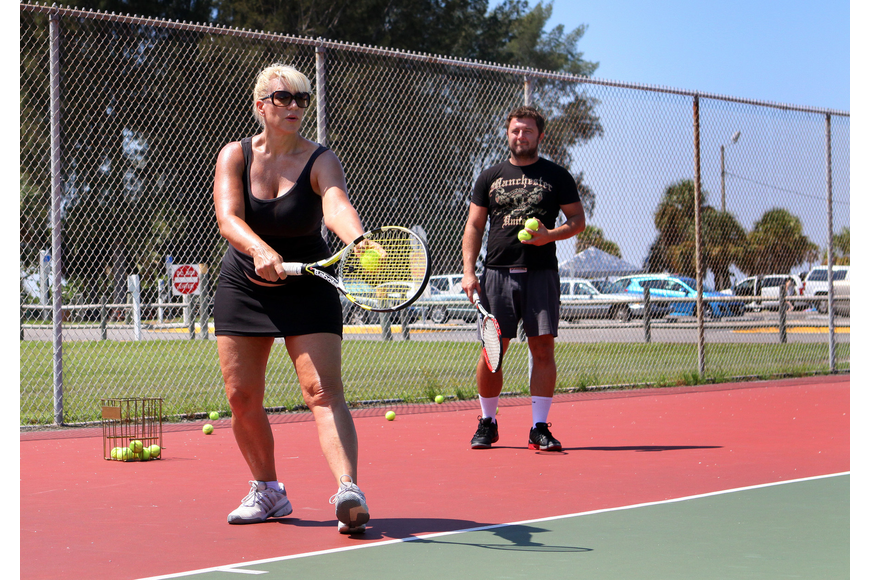 Michelle Zirkle works on her serve during her tennis lesson with tennis pro Michael Skwira out at the Siesta Key Public Beach Courts.