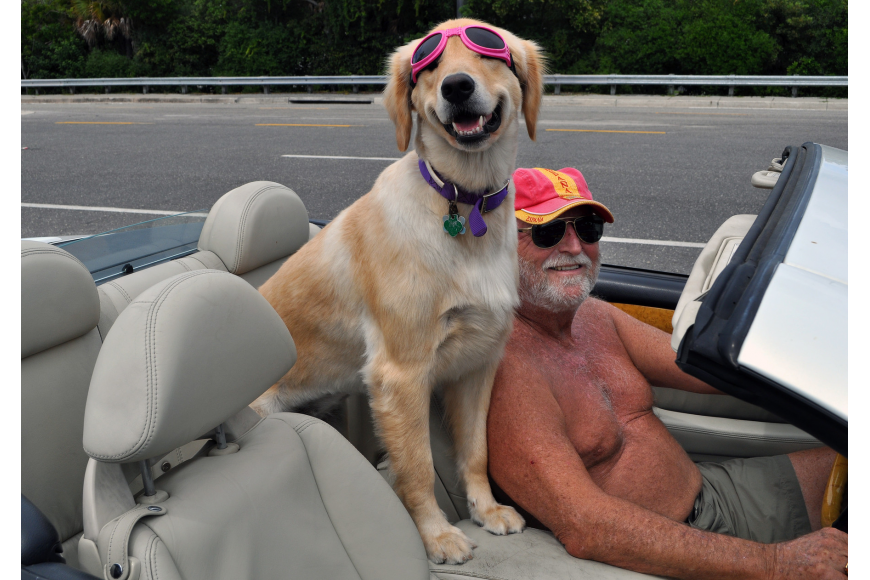 Don Lichter and Jocy, 2, take a ride to the bank in their convertible.