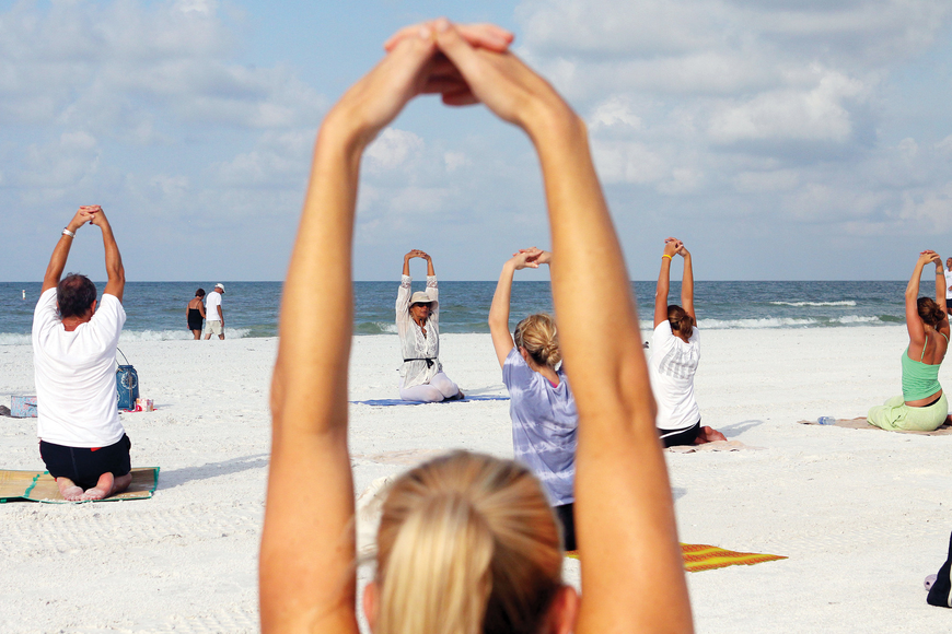 Ava Csiszar's free beach yoga classes have been drawing steady participation on Siesta Key Public Beach. File photo.