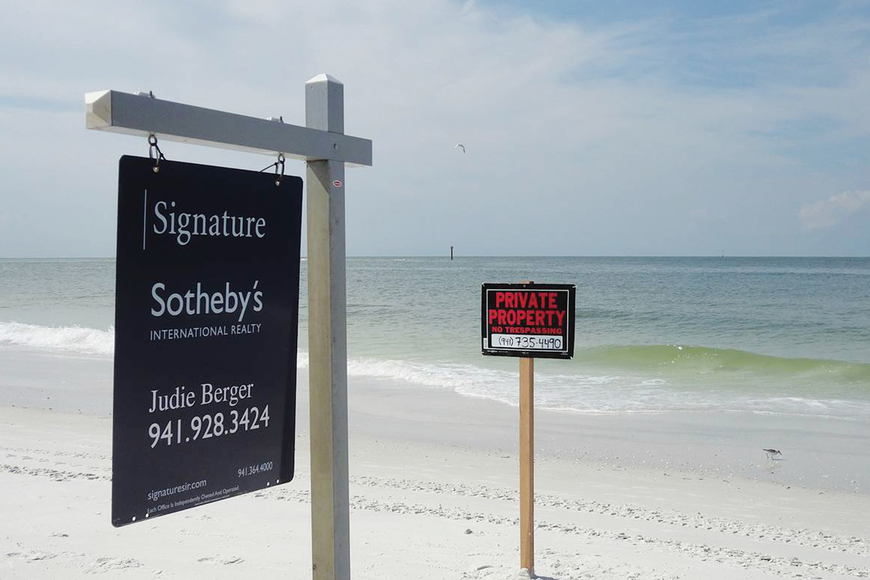 "Neighboring residents complained when Andy Cooper installed real estate and ""Private Property"" signs on the portion of the beach residents considered public access. Courtesy photo."