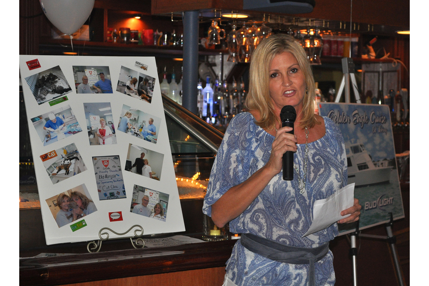 Ashley Banks Matthes talks about SDA and her father's recent passing Thurday, Oct. 6 during the 11th annual Okto-Paw-Fest at the Daiqiuri Deck on SIesta Key.