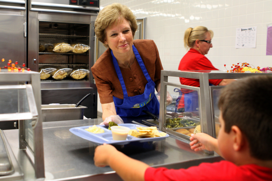 Superintendent Lori White hands over a lunch tray Thursday, Oct. 13, at Gulf Gate Elementary.