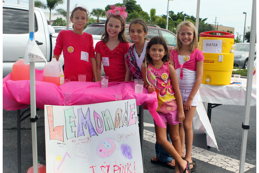 Erin Luhrsen, Ashlynn Rutherford, Savina Koda, Sofia Koda and Ansley Jackson ran a pink lemonade stand out in the parking lot. Last year the girls raised $57.