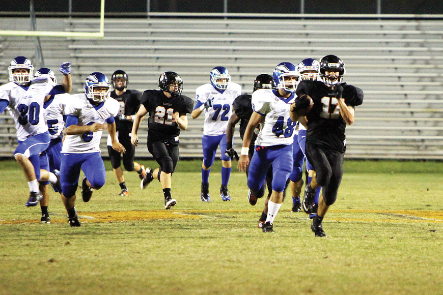 Michael Dancer, No. 17, makes his way down the field to score a touchdown for the Sarasota Sailors Friday, Oct. 14, during the homecoming game against the East Lake Eagles at Cleland Stadium. Sarasota High lost 38-52. Photo by: Rachel S. O'Hara