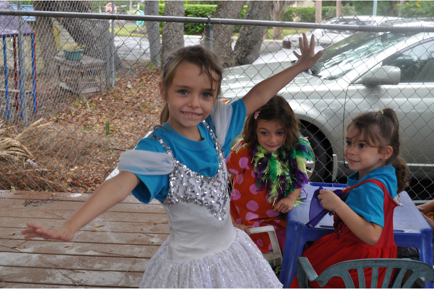 Linda Harris shows off her ballerina princess skills for Claire Macaluso and Giovanna Hansen.