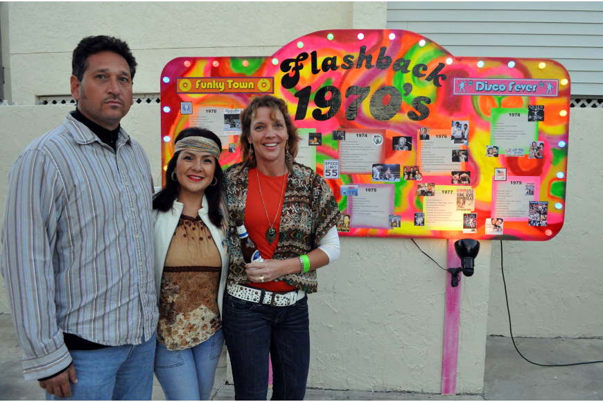 Gregory and Veronica Bever pose with Kay Kouvatsos by the funky timeline at Sandfest 2011, Friday, Nov. 4, at Siesta Key Beach Pavilion.