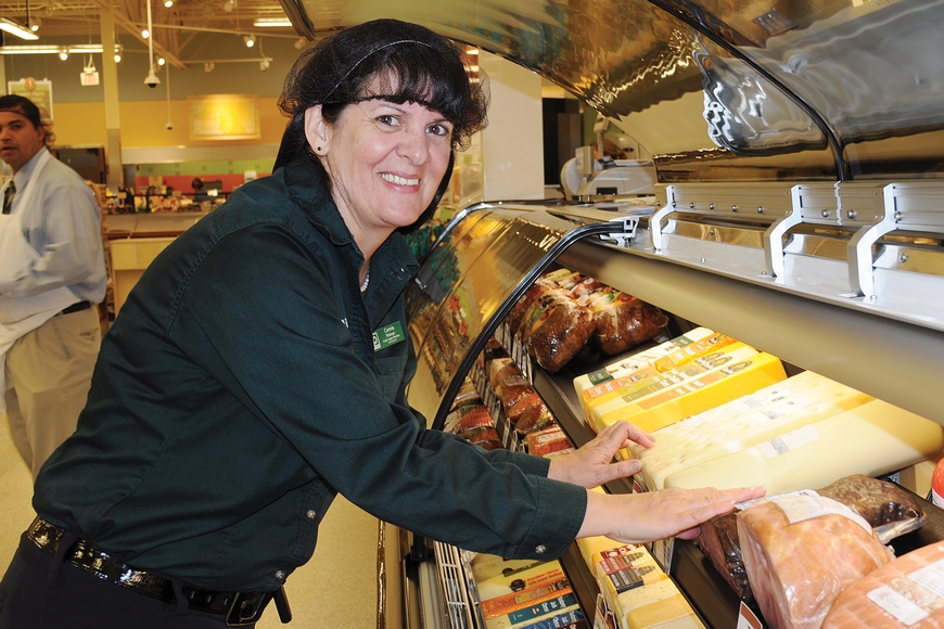Connie Pittman helps prepare the Publix store for its grand opening.